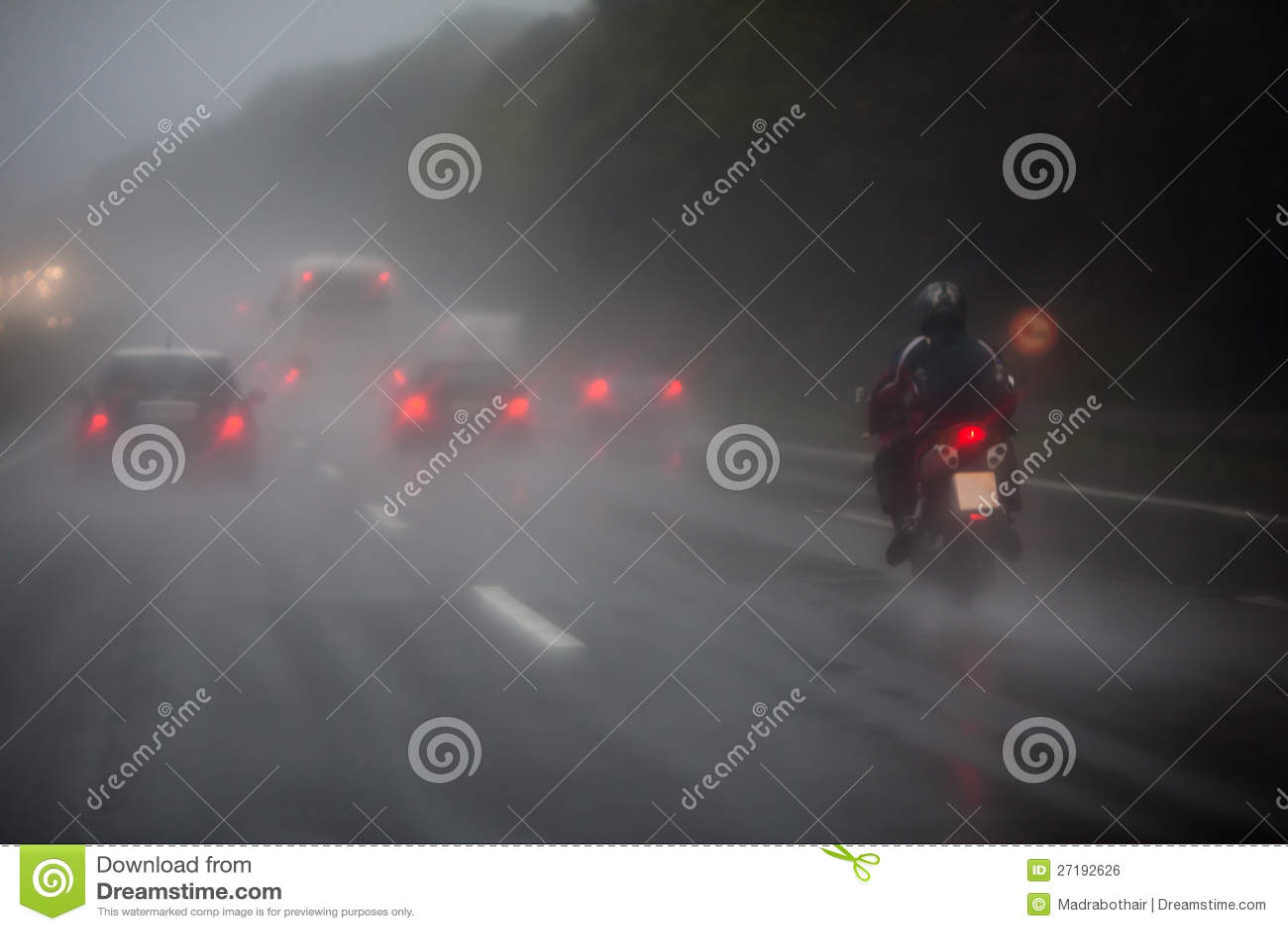 Traffic on the autobahn with heavy rain