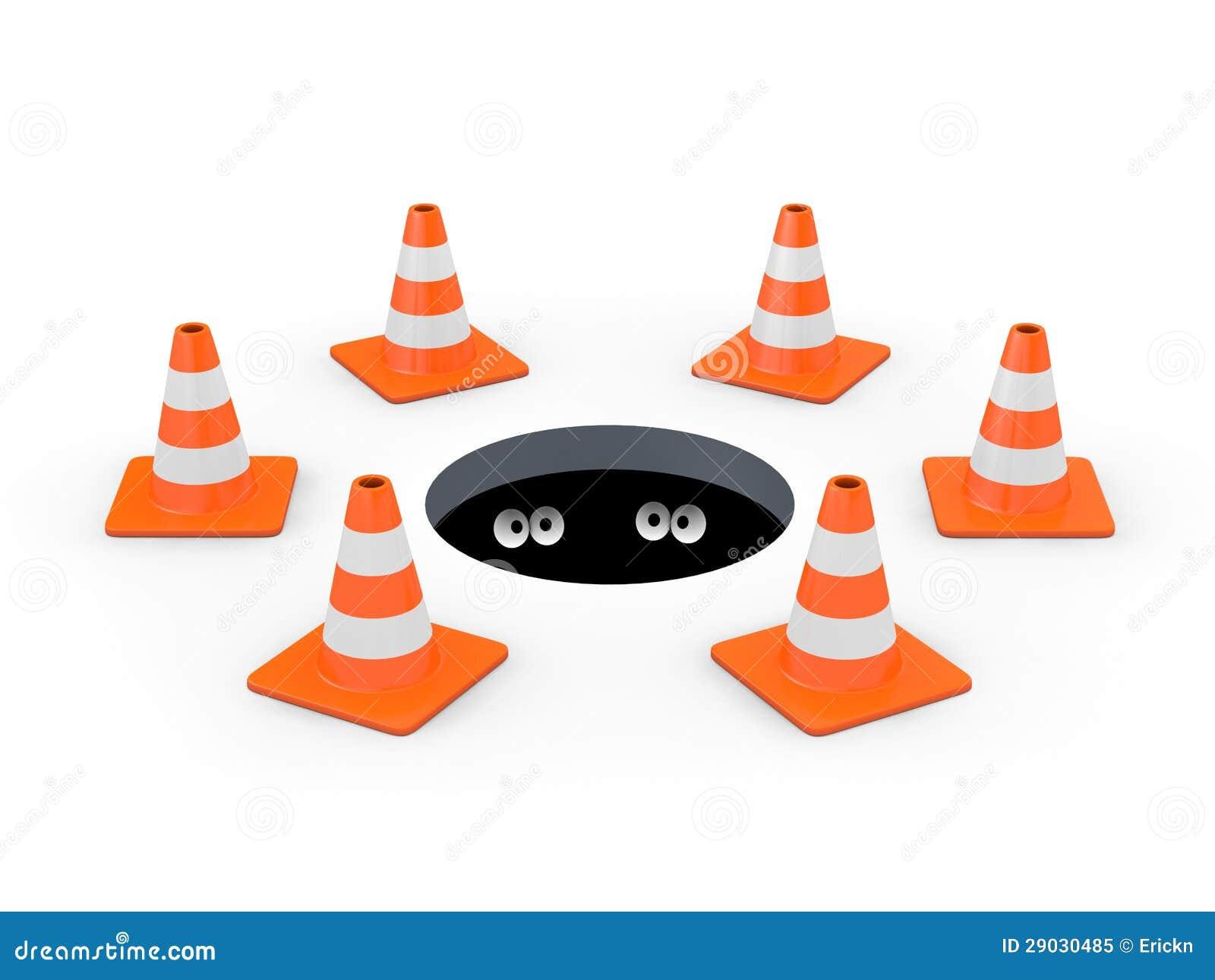 Traffic Cones Around A Manhole Royalty Free Stock Photo