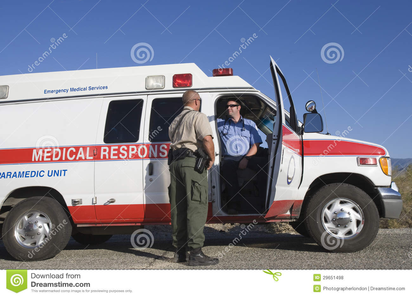Traffic Cop Talking With EMT Doctor