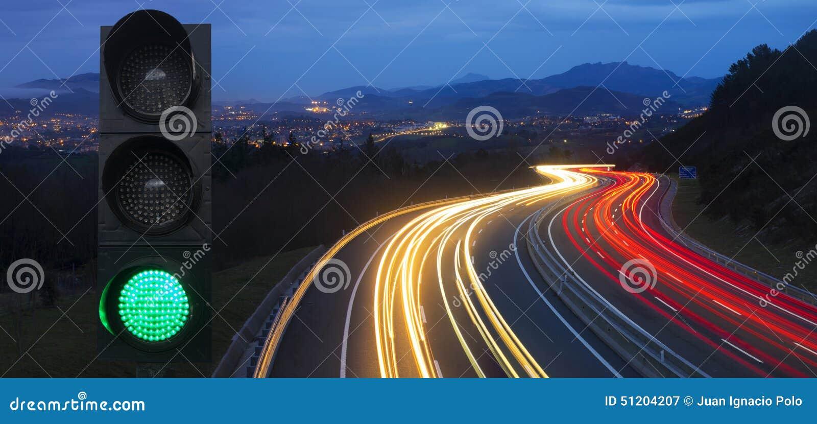 Traffic lights and car lights at night