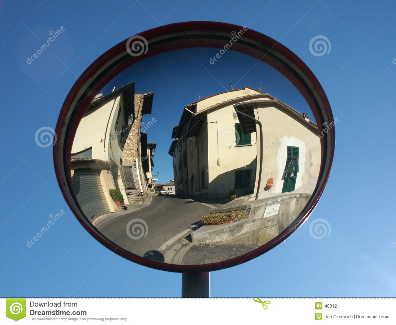 Traffic mirror reflecting small town