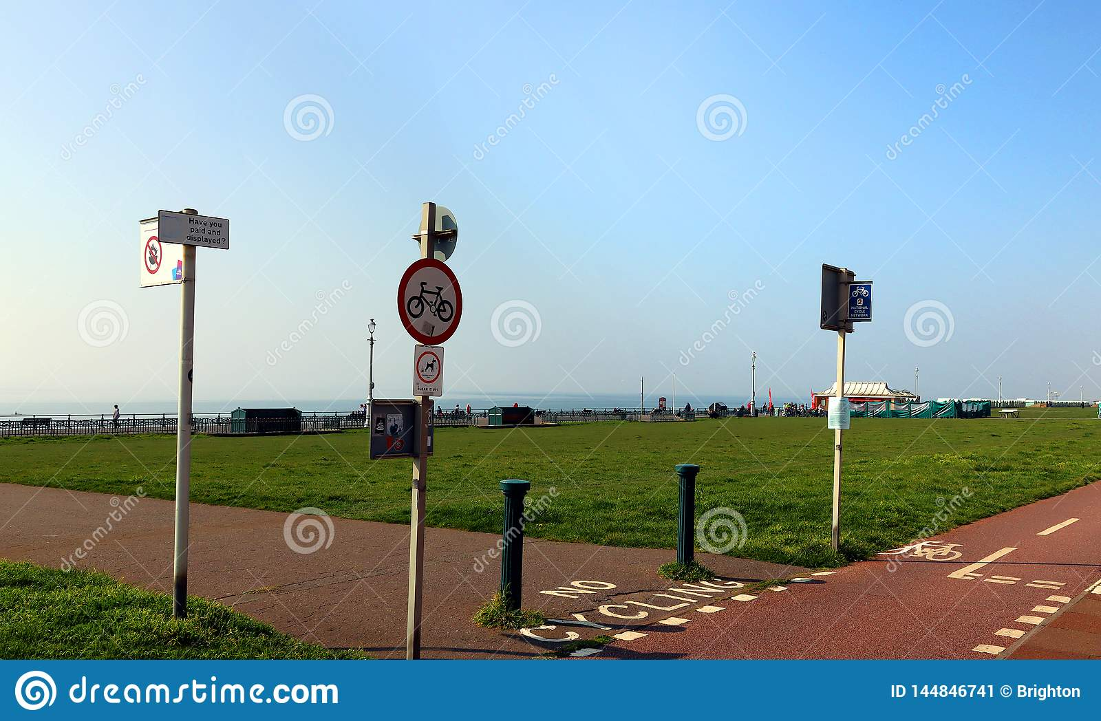 Traffic signs by bike lanes on Hove Promenade