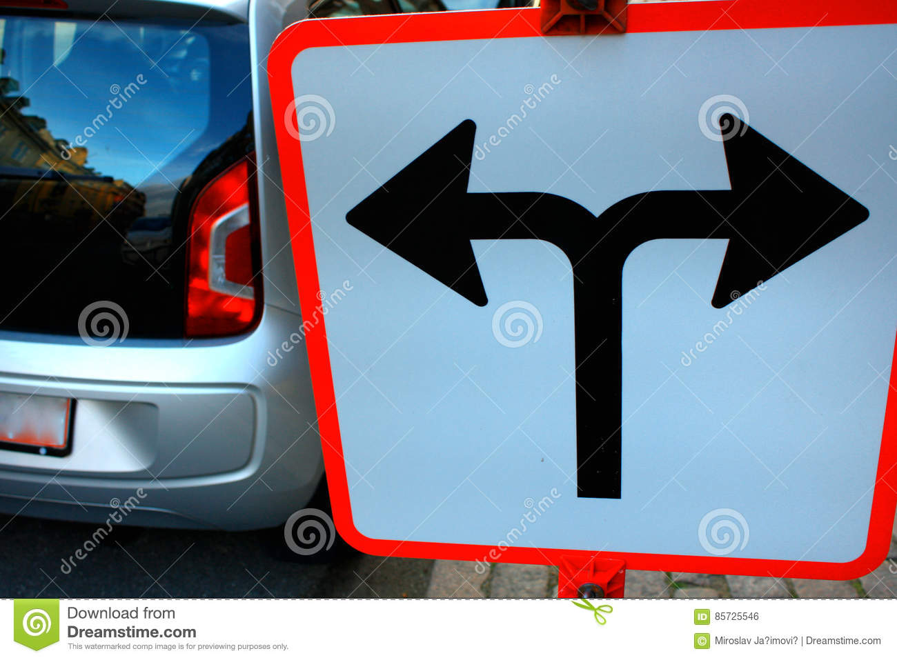 Traffic Signs in front of crossroad, Direction turn left or turn