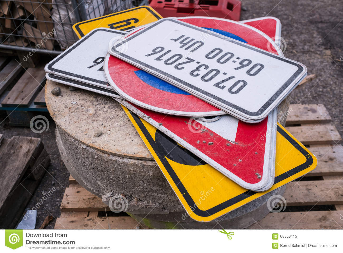 Traffic signs on a stone at a roadwork