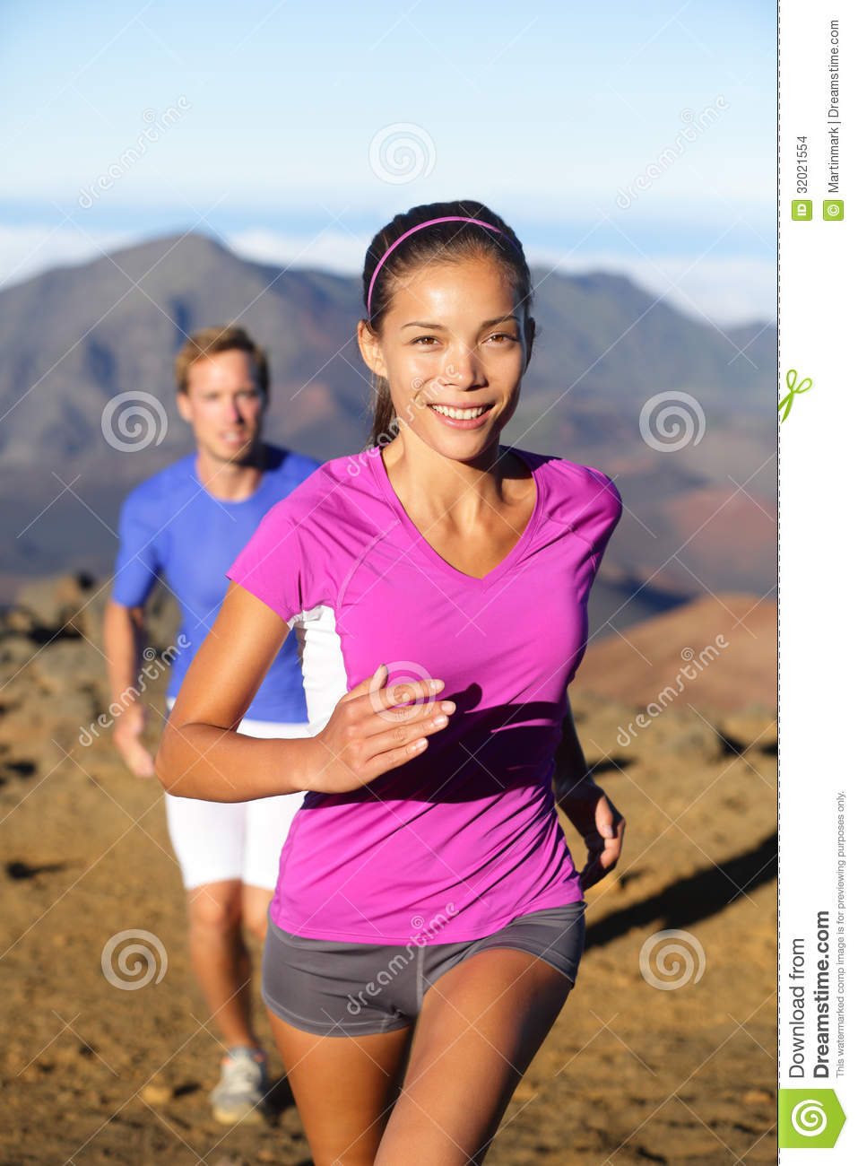Trail running women runner. Healthy lifestyle concept with runners