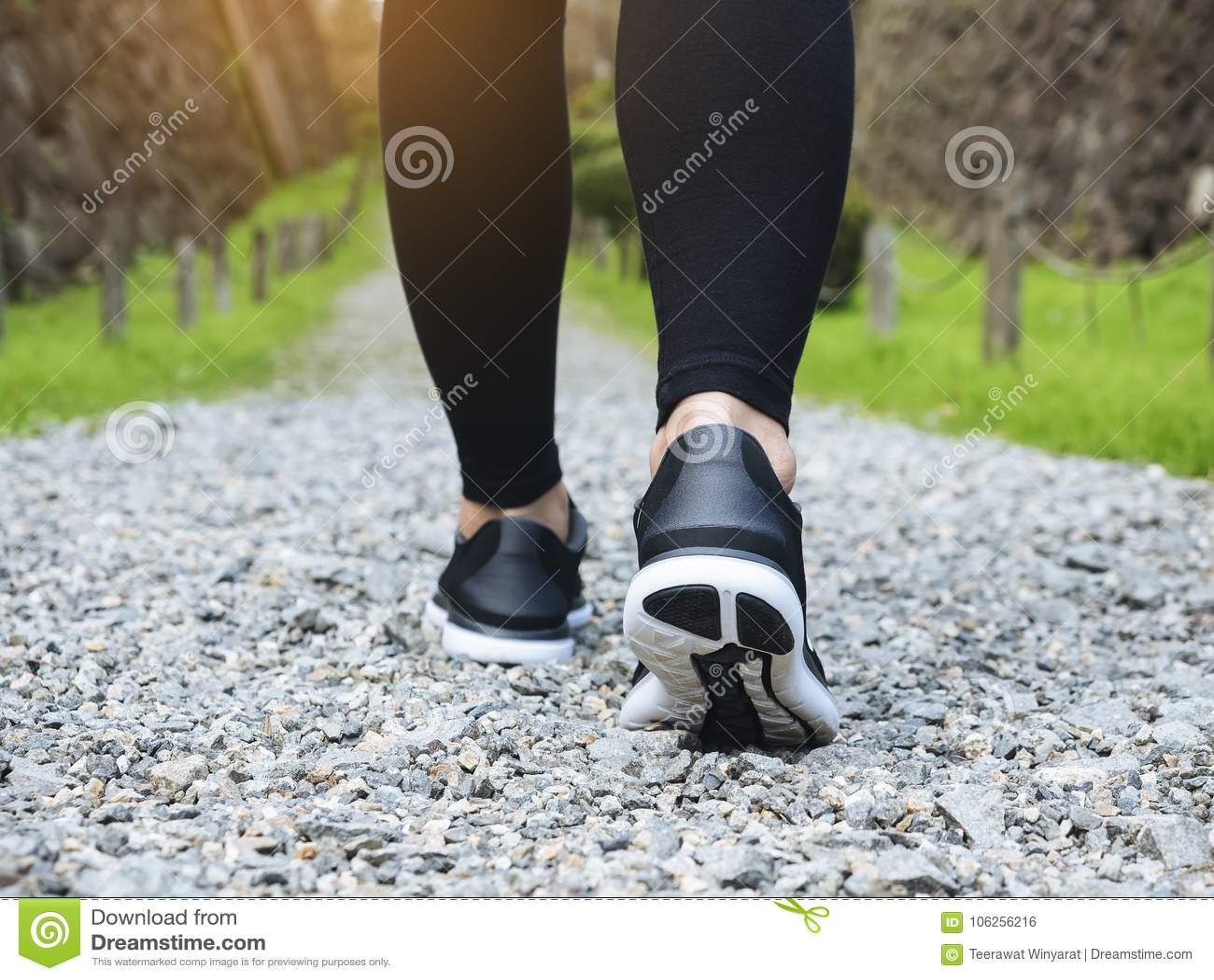 Trail walking woman legs with sport shoe Trailt Park outdoor