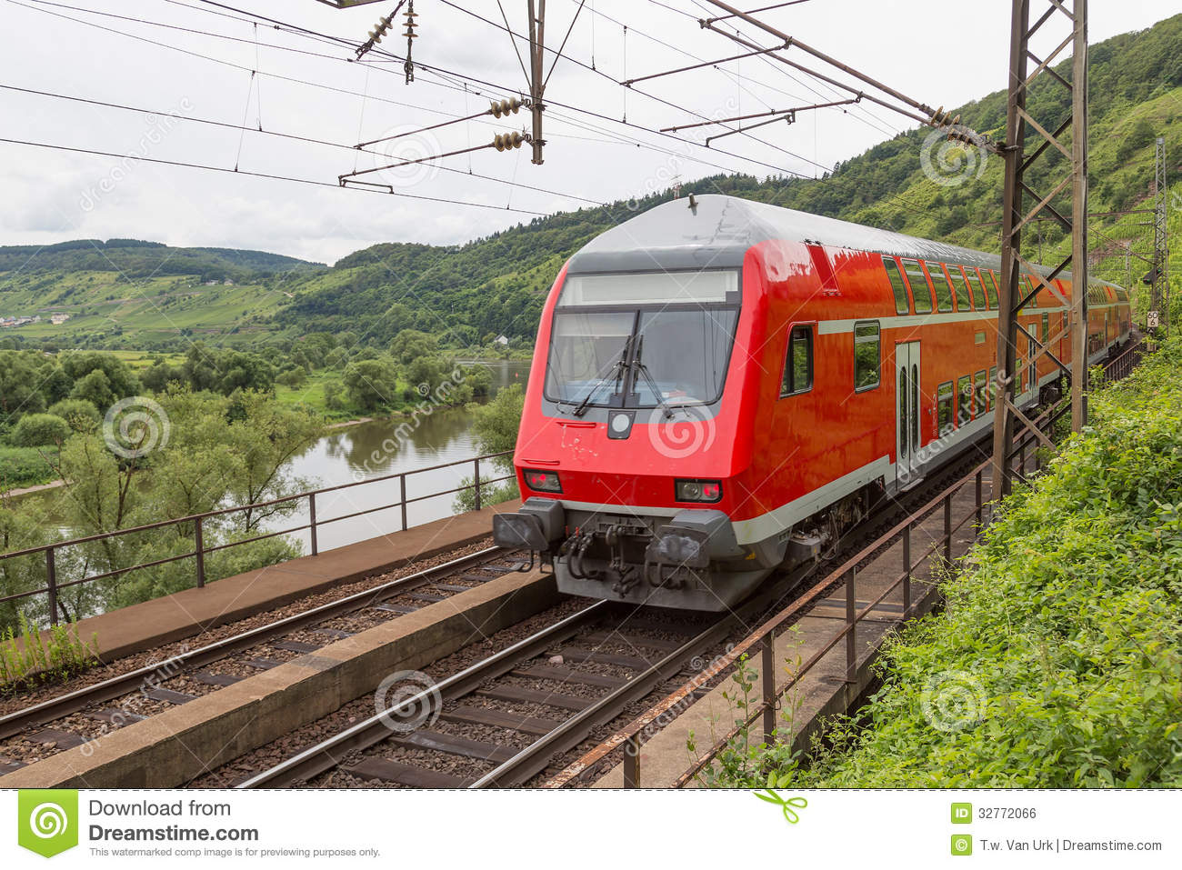 Train Driving Along German River Moselle Royalty Free