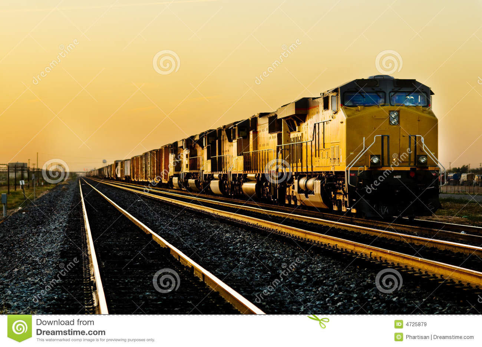 Train locomotive traveling through desert