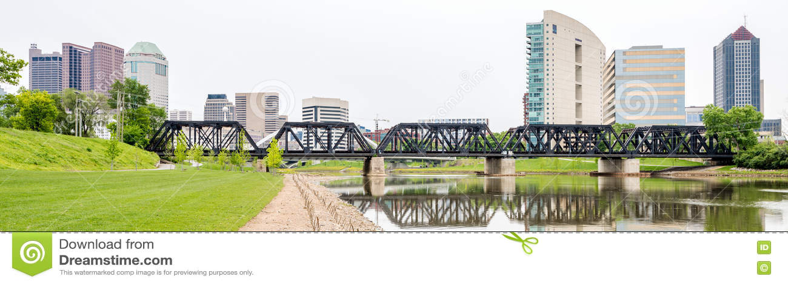 Train tracks over the river and Columbus Ohio skyline