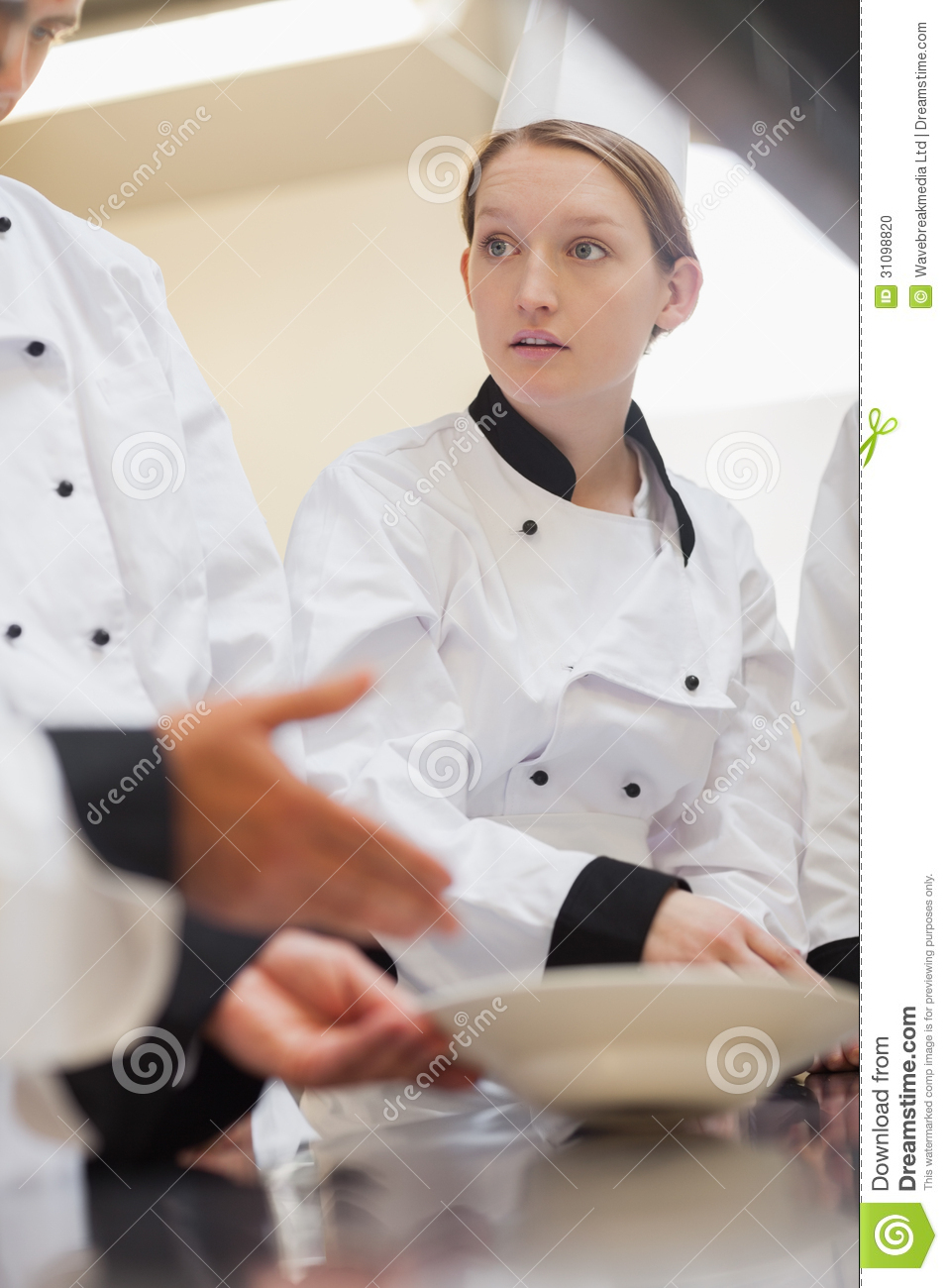 Trainee Chef Listening To Teacher Stock Photo - Image: 31098820
