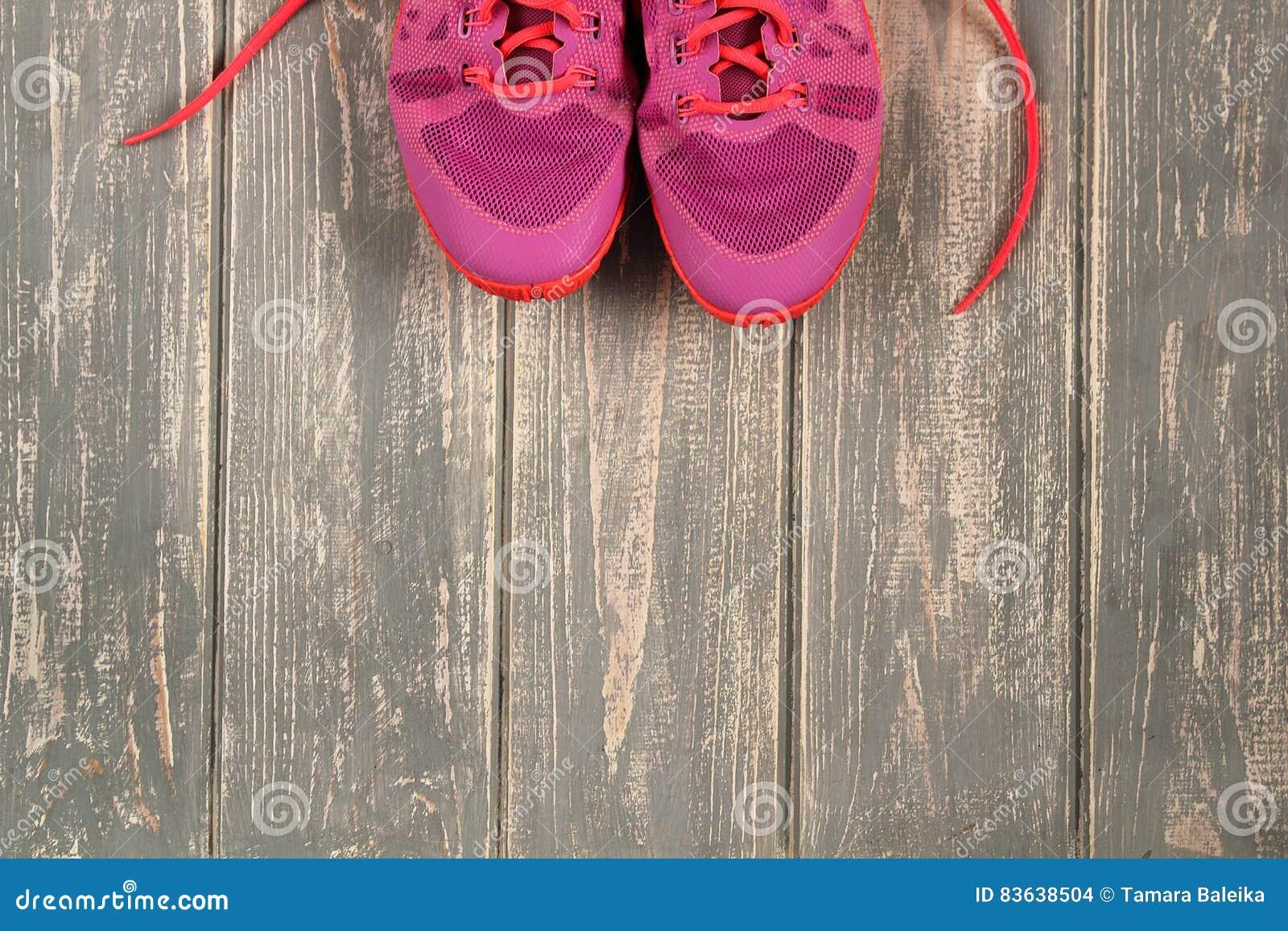 Trainers on wood floor.