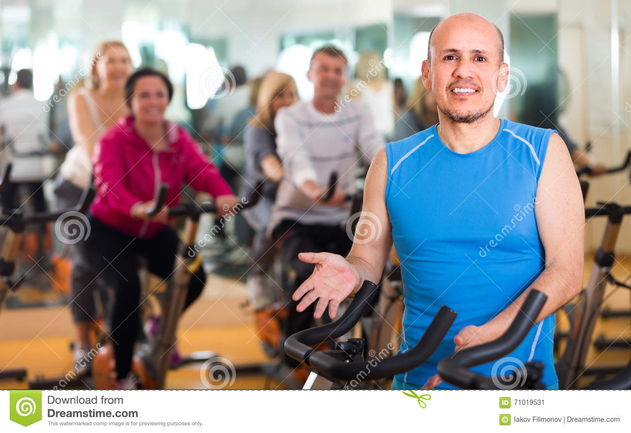 Training in sport club on fitness cycle