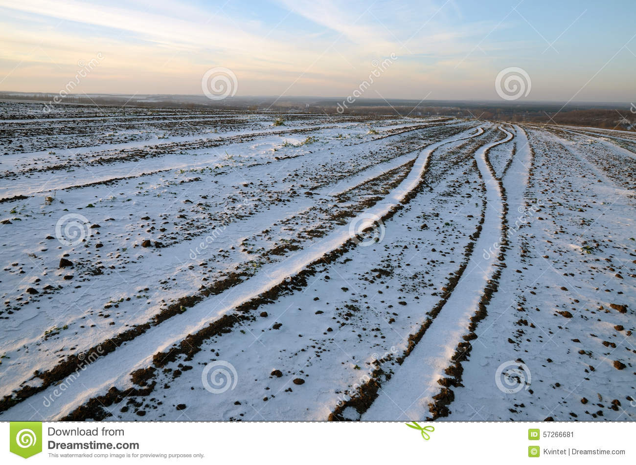 The trajectory of the way an a plowed field and covered with snow