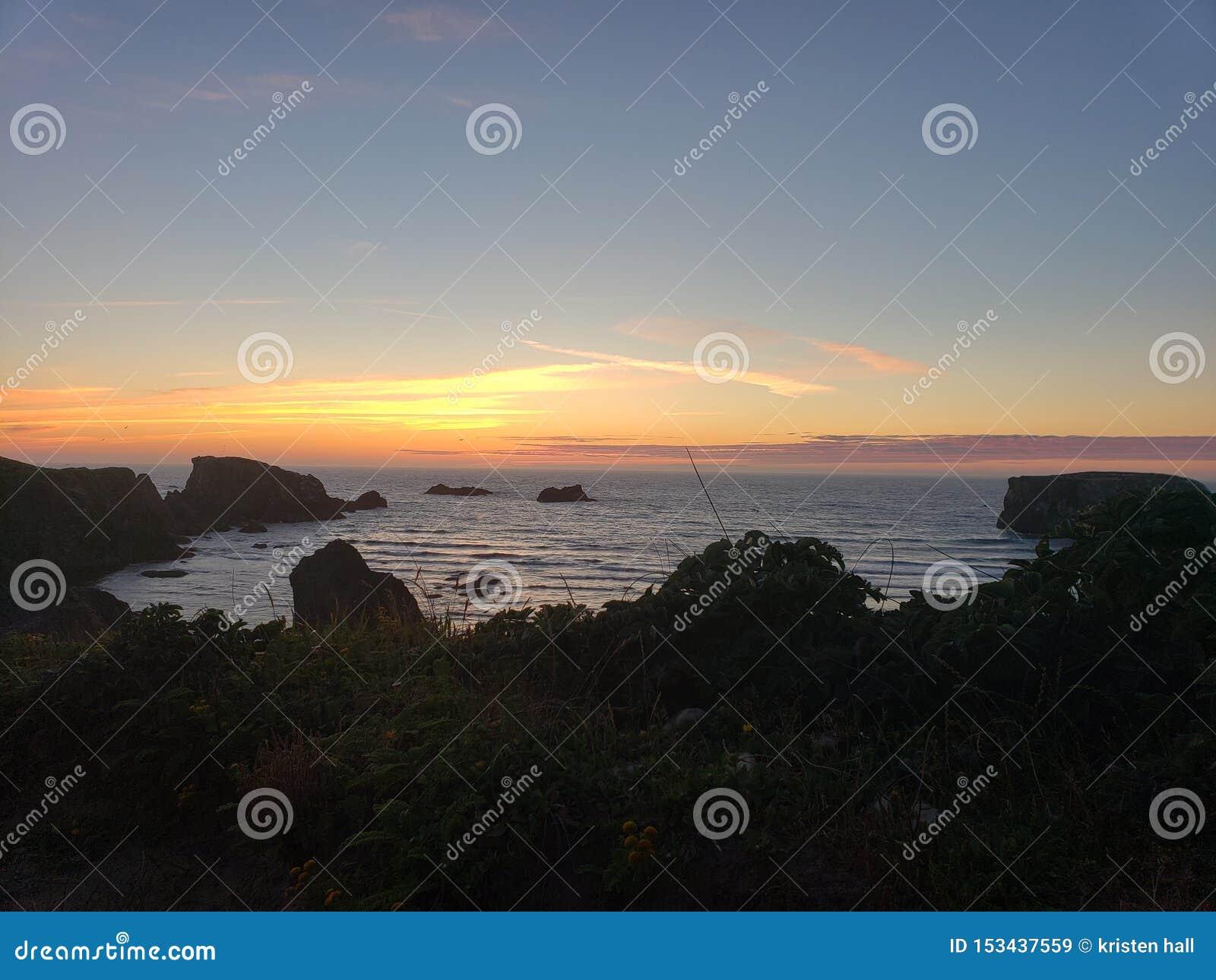 Tramonto della spiaggia della costa dell Oregon