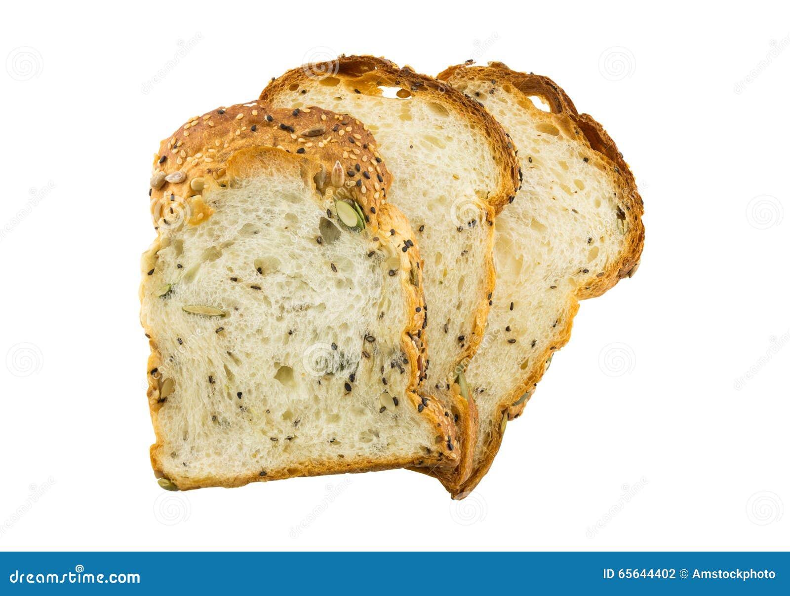 Tranche de pain entier de grains d isolement sur le fond blanc