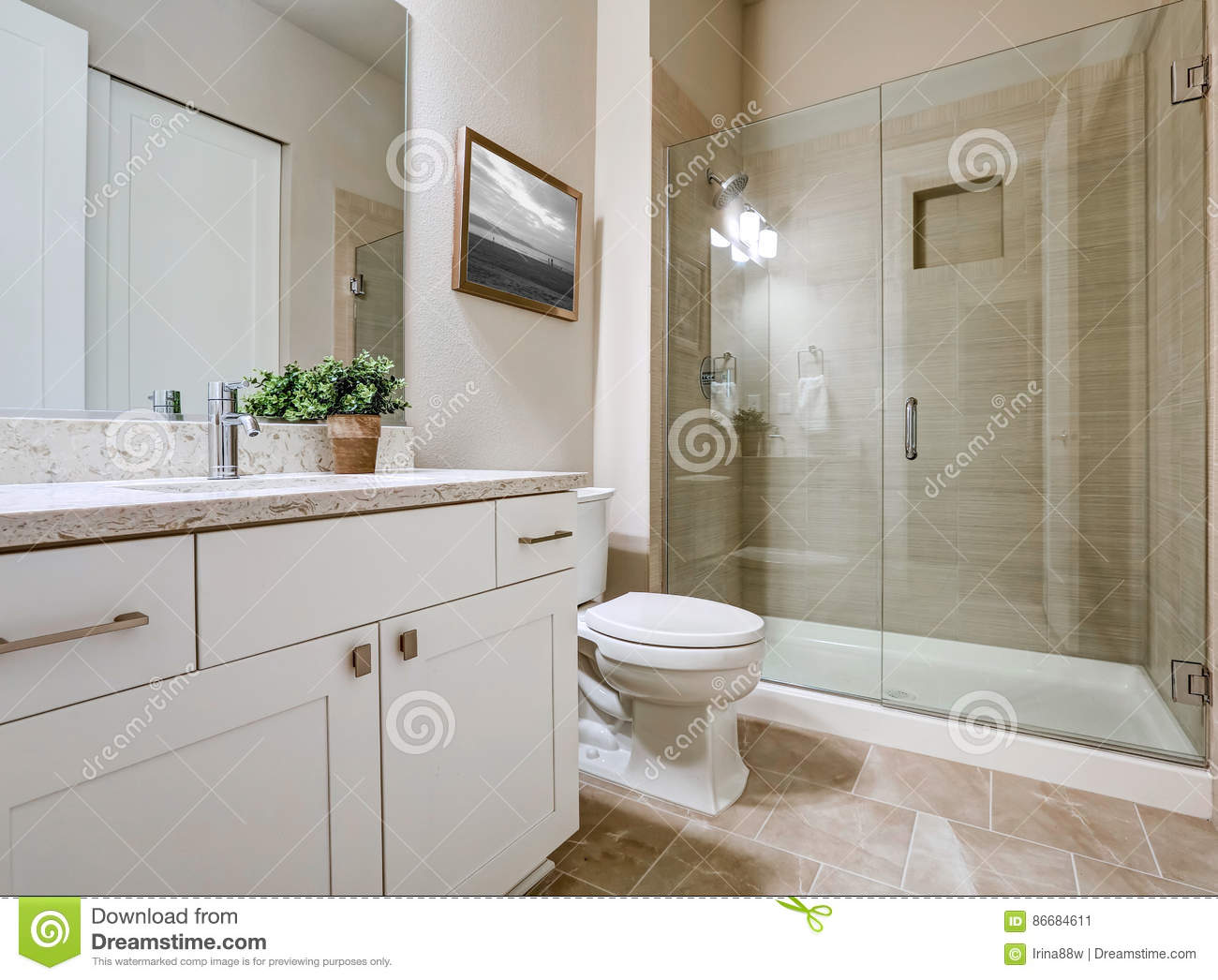 beige bathroom interior with white bath tub and glass shower royalty free stock photo. Black Bedroom Furniture Sets. Home Design Ideas