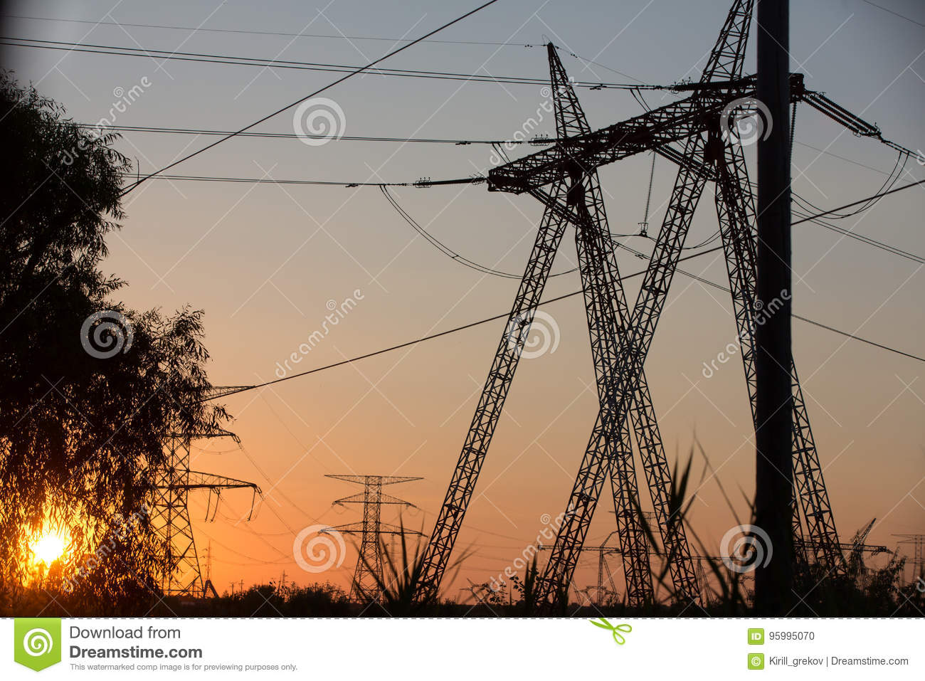 Transmission power line silhouette on sunset