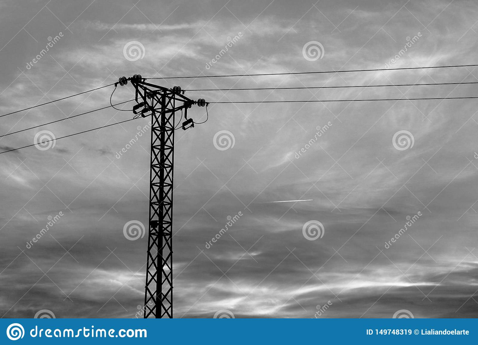 Transmission tower and moving clouds