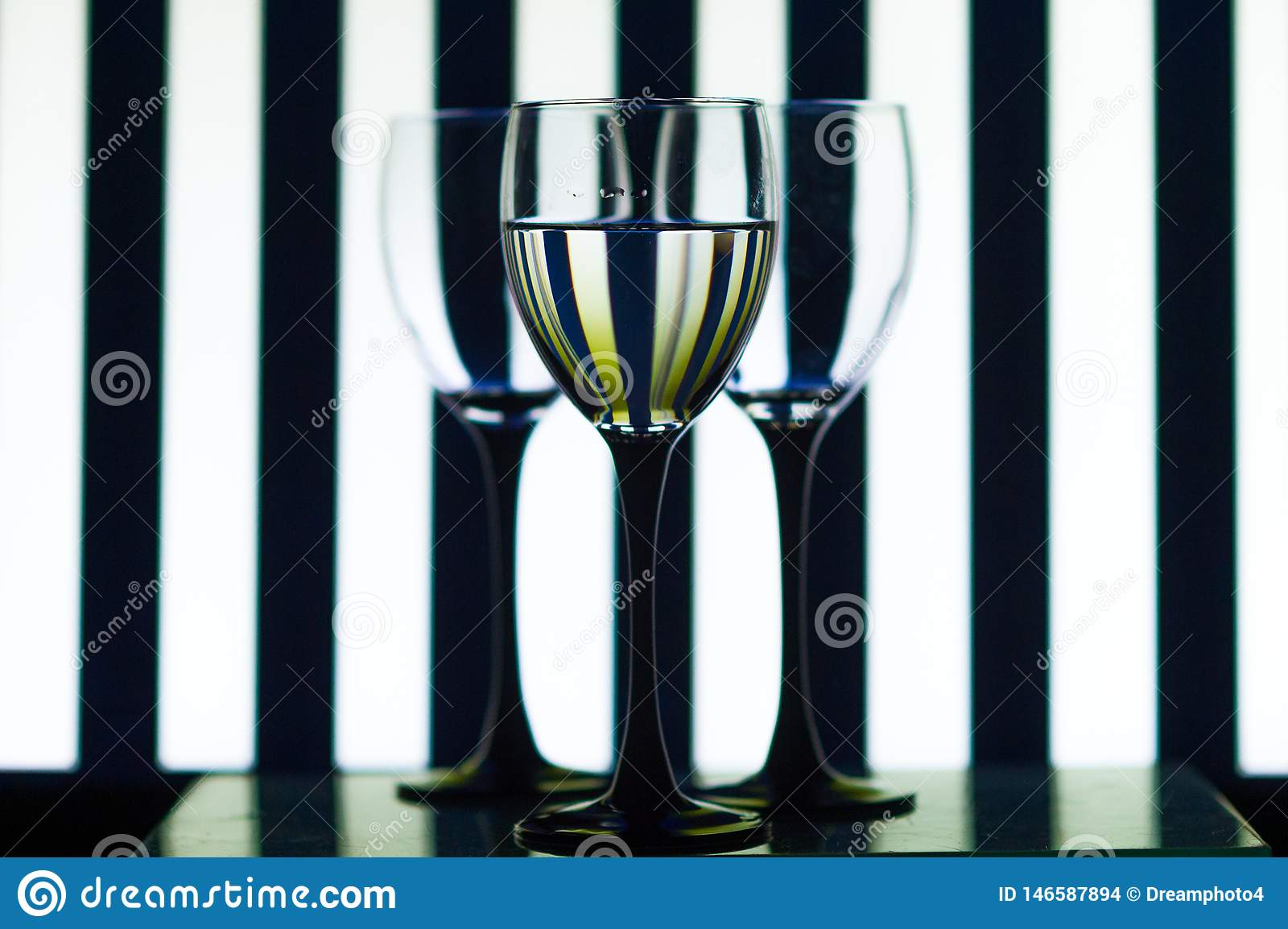 Glass glasses on the background strips
