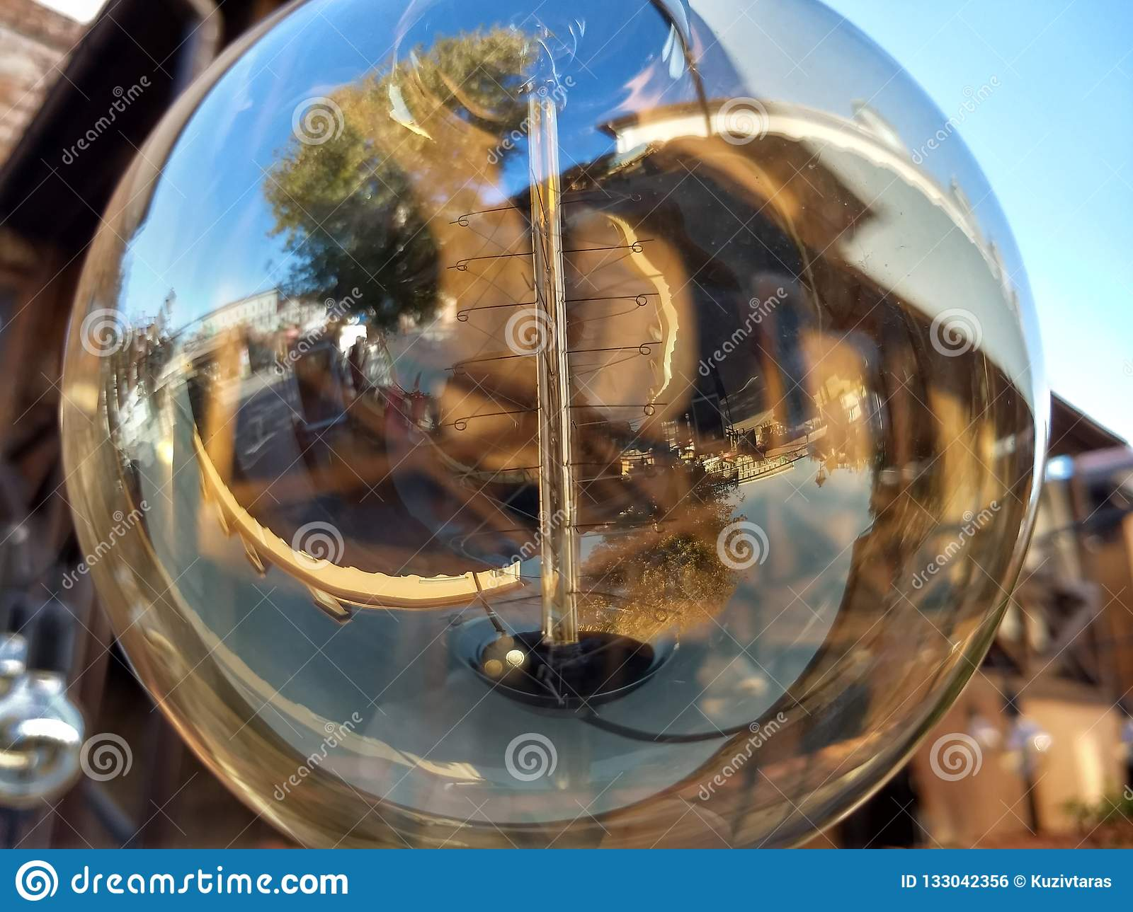 Transparent round bulb of the street lamp