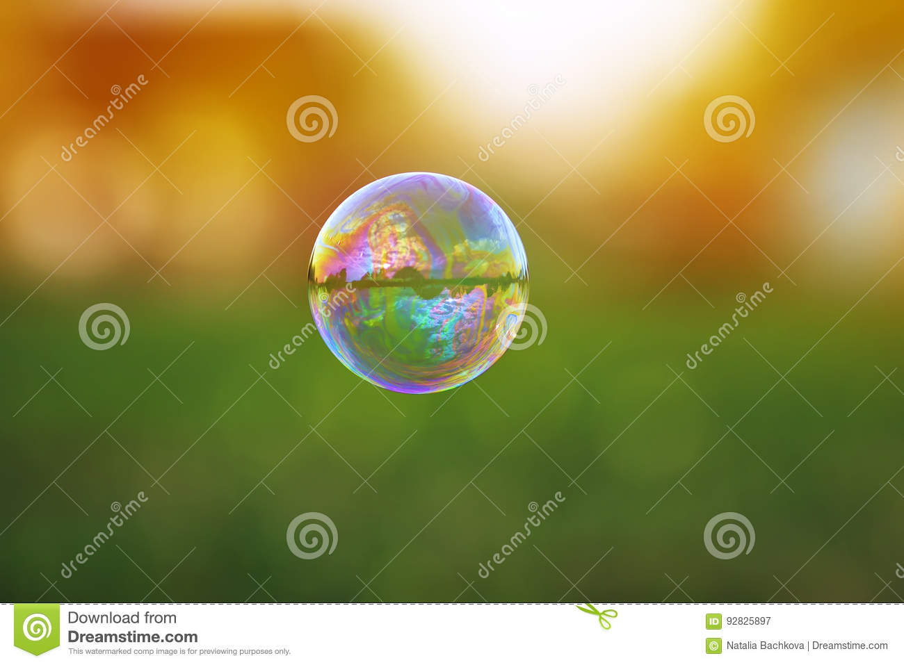 transparent soap bubble with a shimmering flying over a S
