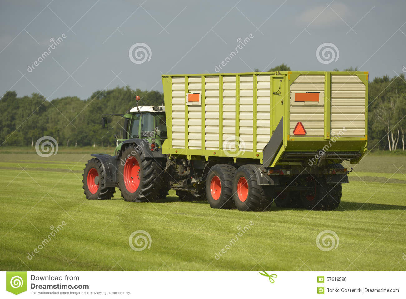 Tractor Trailer Stock : Transport of cut grass with tractor and trailer stock