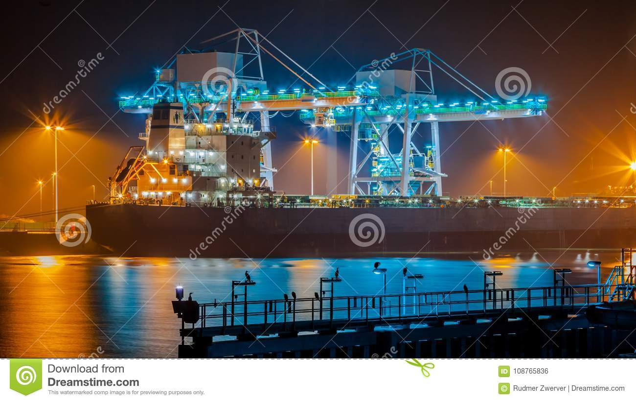 Transport Ship In Harbor At Night