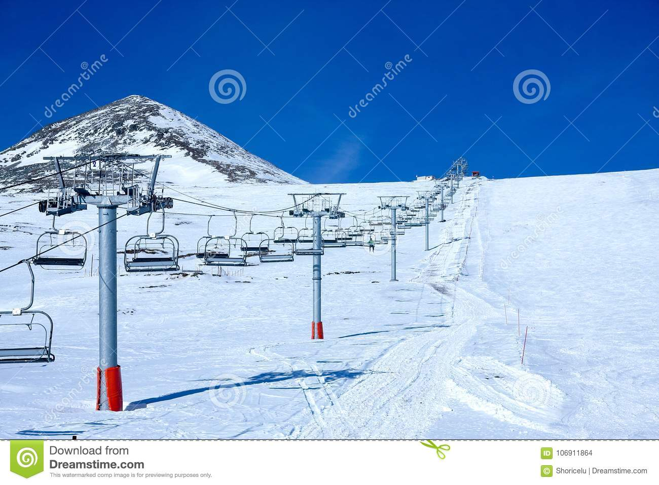ski lift on a sunny mountain slope stock photo - image of sheets