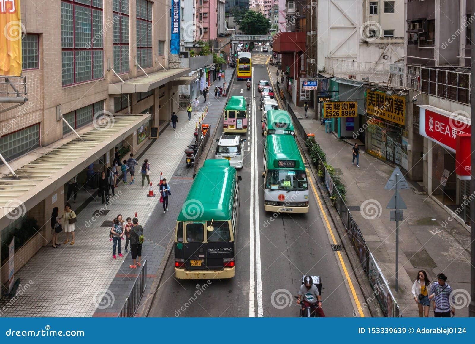 Transporte y peatones en la calle, Hong-Kong