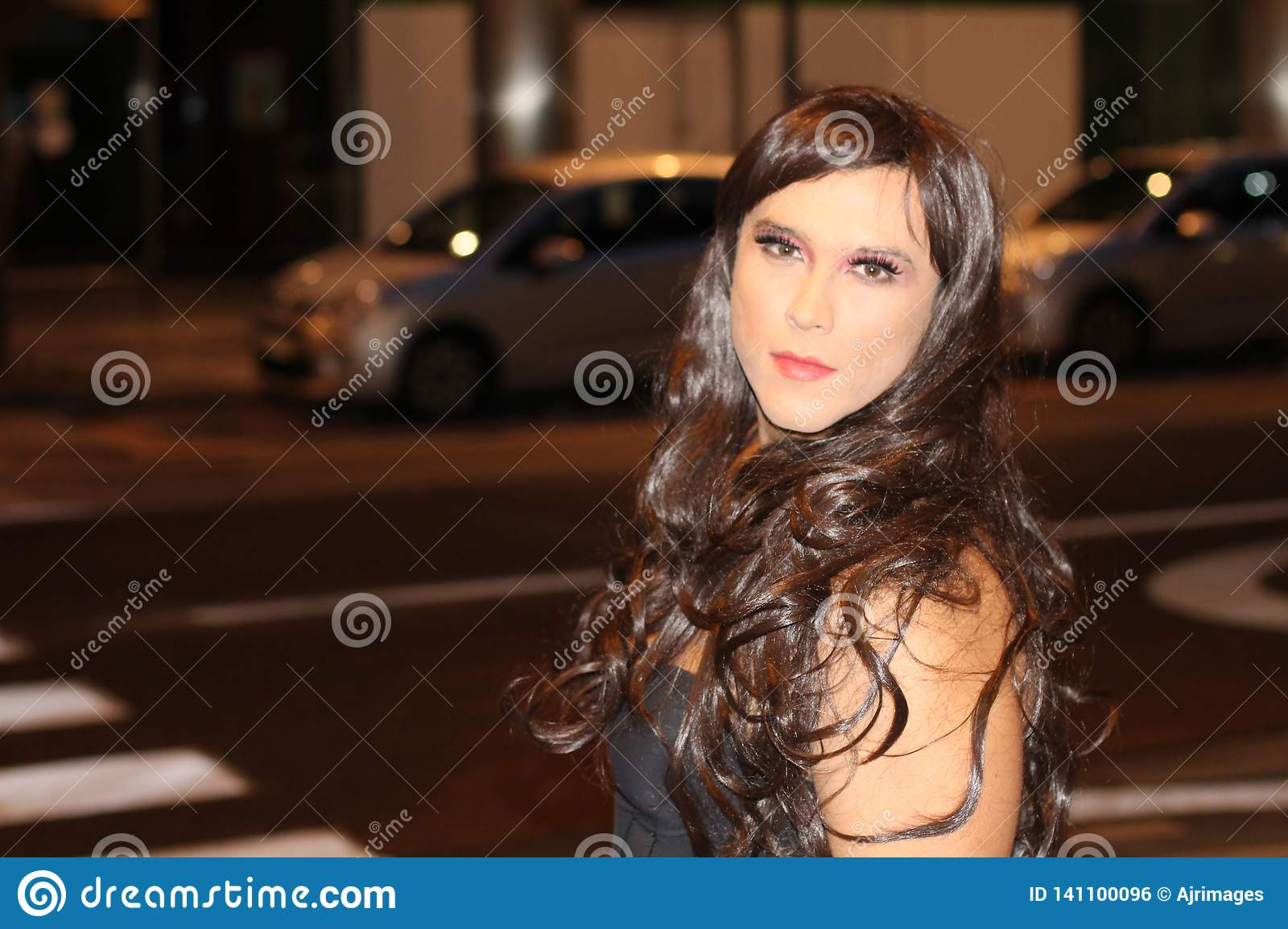 Transvestite outdoors with copy space
