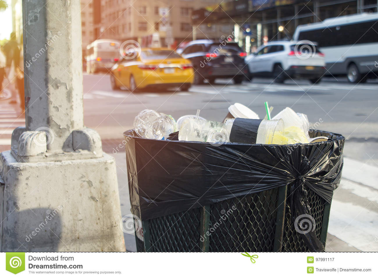 Trash With Cars In Background On Busy City Street New York Stock ...