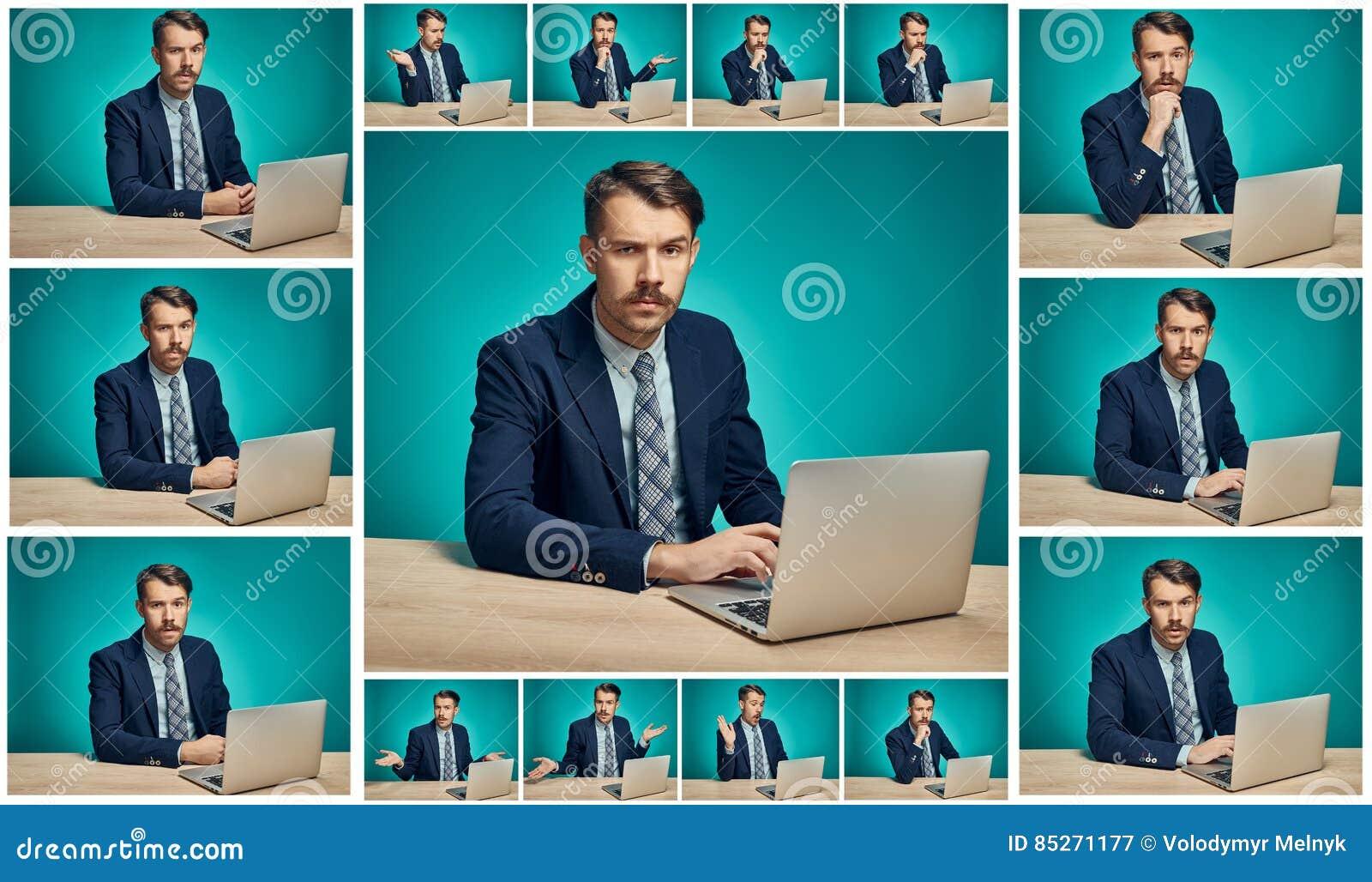 Trauriger junger Mann, der an Computer am Schreibtisch arbeitet