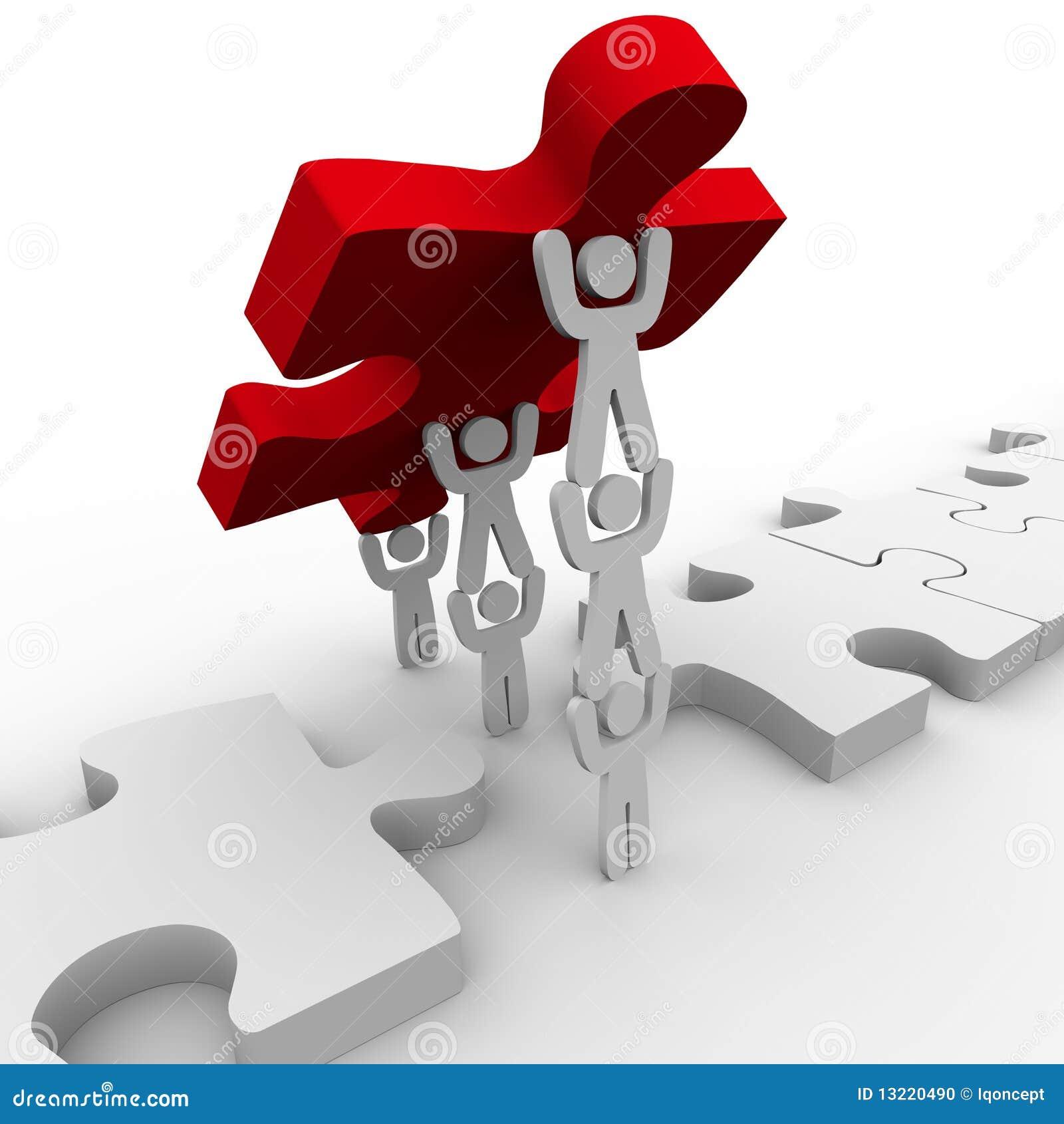 Travail d équipe plaçant la partie finale dans le puzzle