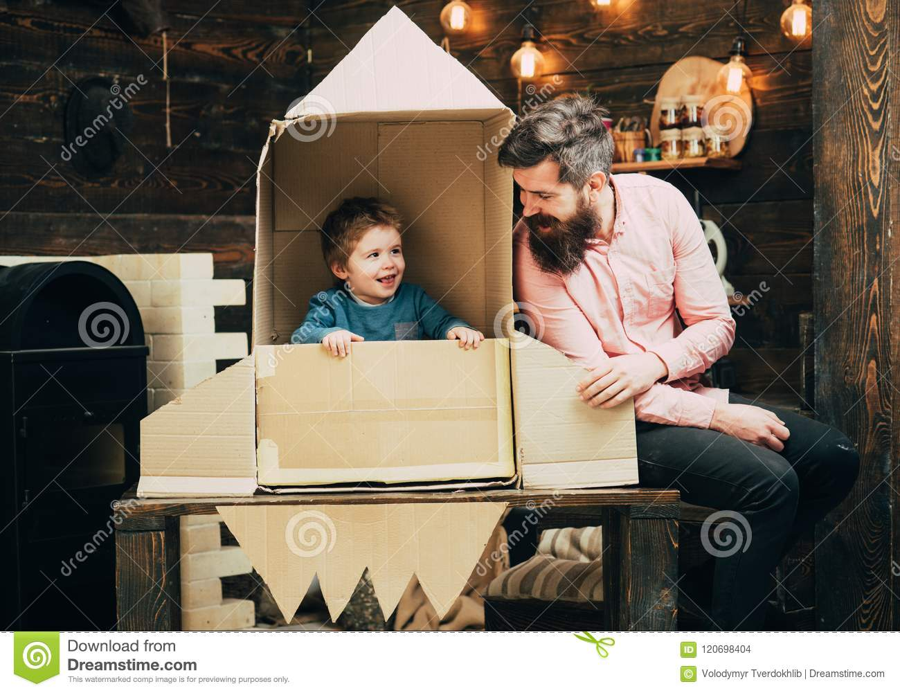 Travel and adventure. Father and small boy in paper rocket. Family and childhood. Earth day concept. father day. Dream