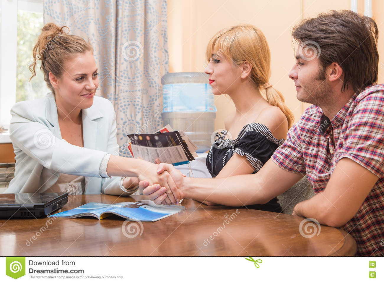 Travel Agent Closing A Deal With Two Customers Stock Image Image