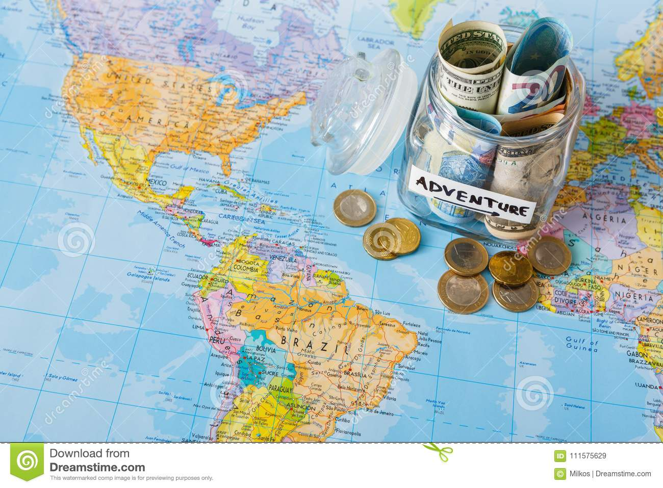 Travel budget concept money saved for vacation in glass jar on map download comp gumiabroncs Gallery