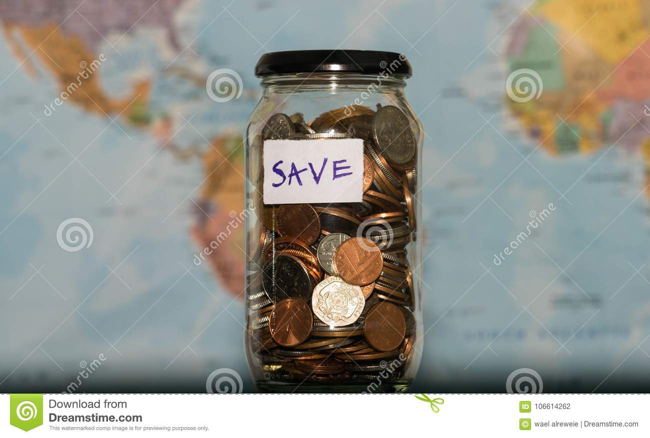 Travel budget concept money saved for vacation in glass jar on royalty free stock photo download travel budget concept money saved for vacation in glass jar on world map background gumiabroncs Images