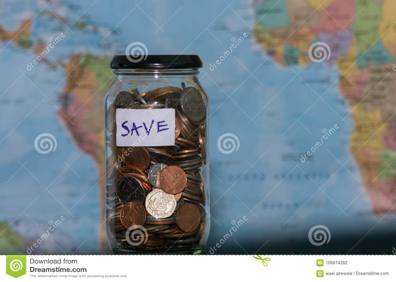 Travel budget concept money saved for vacation in glass jar on royalty free stock photo download travel budget concept money saved for vacation in glass jar on world map background gumiabroncs Gallery