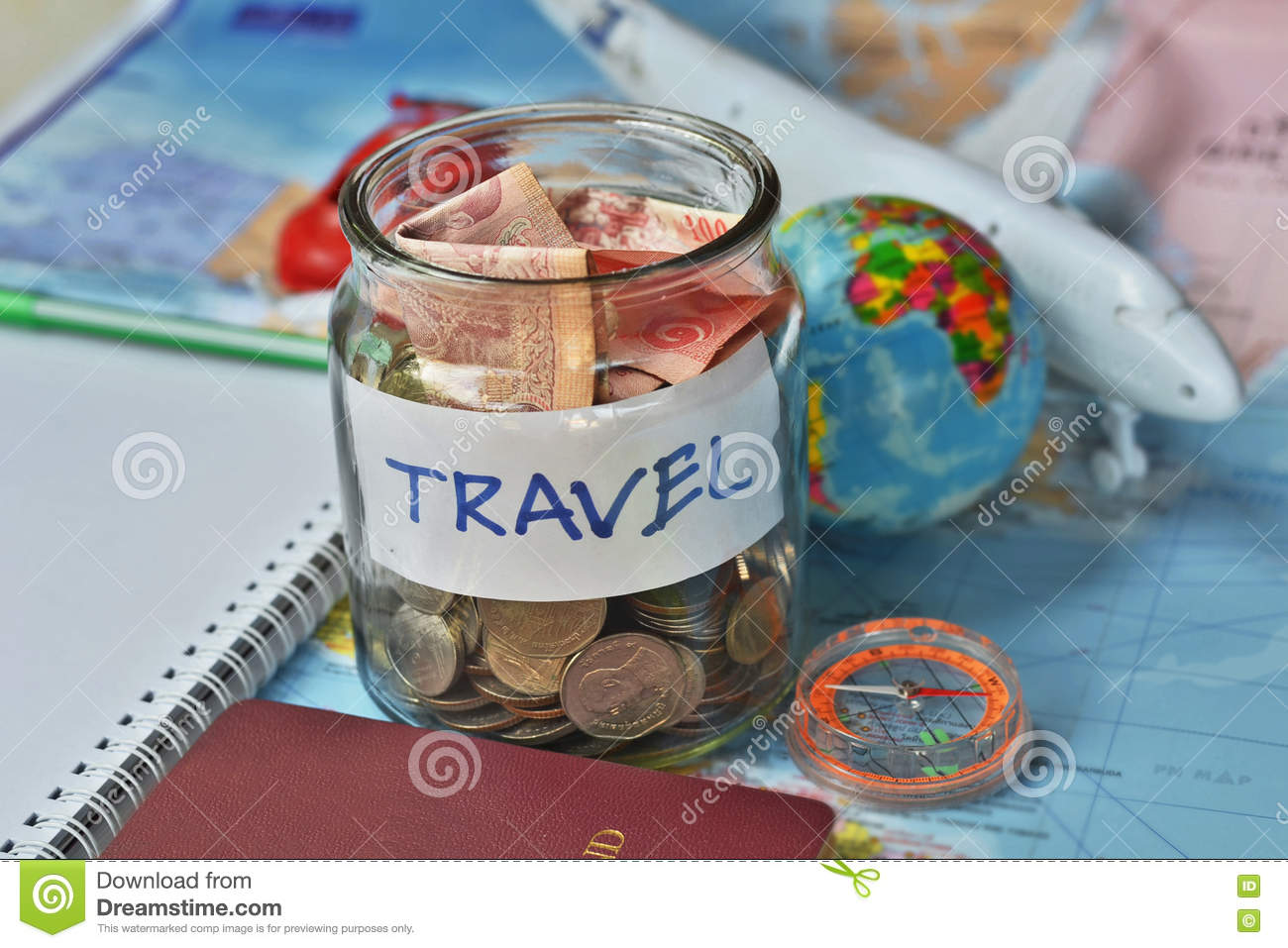Travel budget concept travel money savings in a glass jar with travel budget concept travel money savings in a glass jar with compass passport and aircraft toy gumiabroncs Gallery