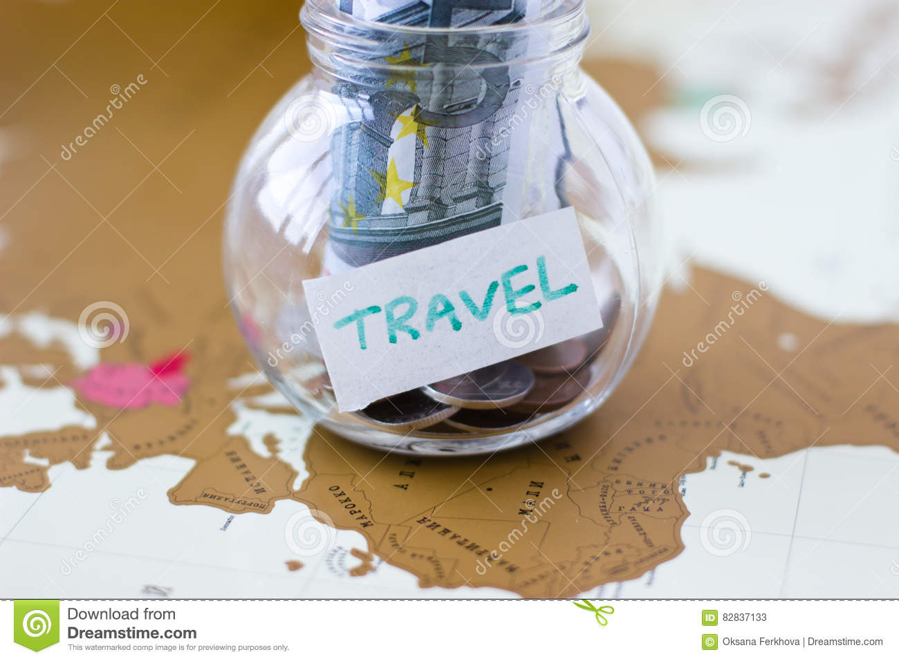 Travel budget vacation money savings in a glass jar on world m royalty free stock photo gumiabroncs Images