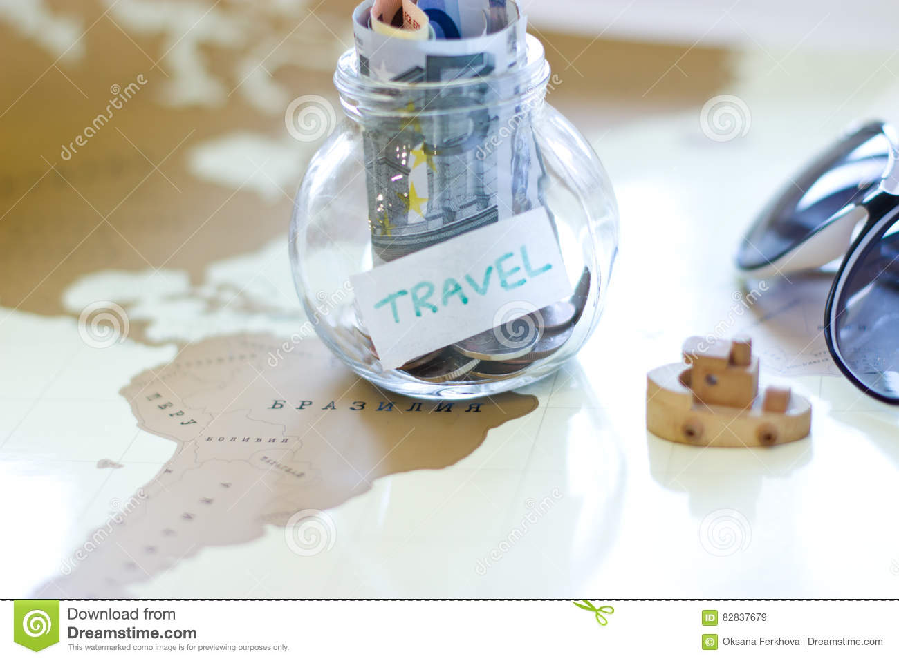 Travel budget vacation money savings in a glass jar on world map jar on world map royalty free stock photo gumiabroncs Images