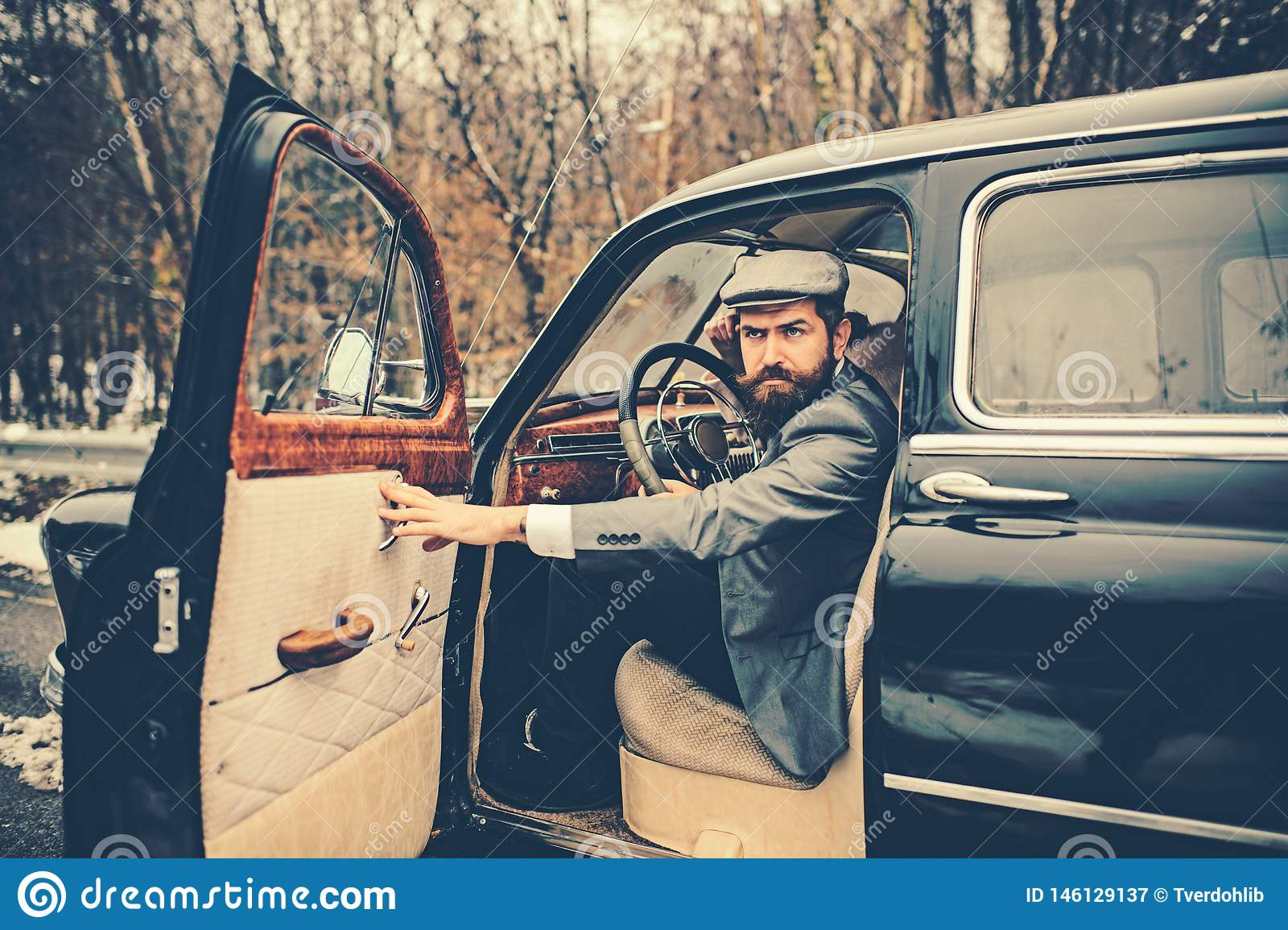 Travel and business trip or hitch hiking. Escort man or security guard. Call boy in vintage auto. Bearded man in car