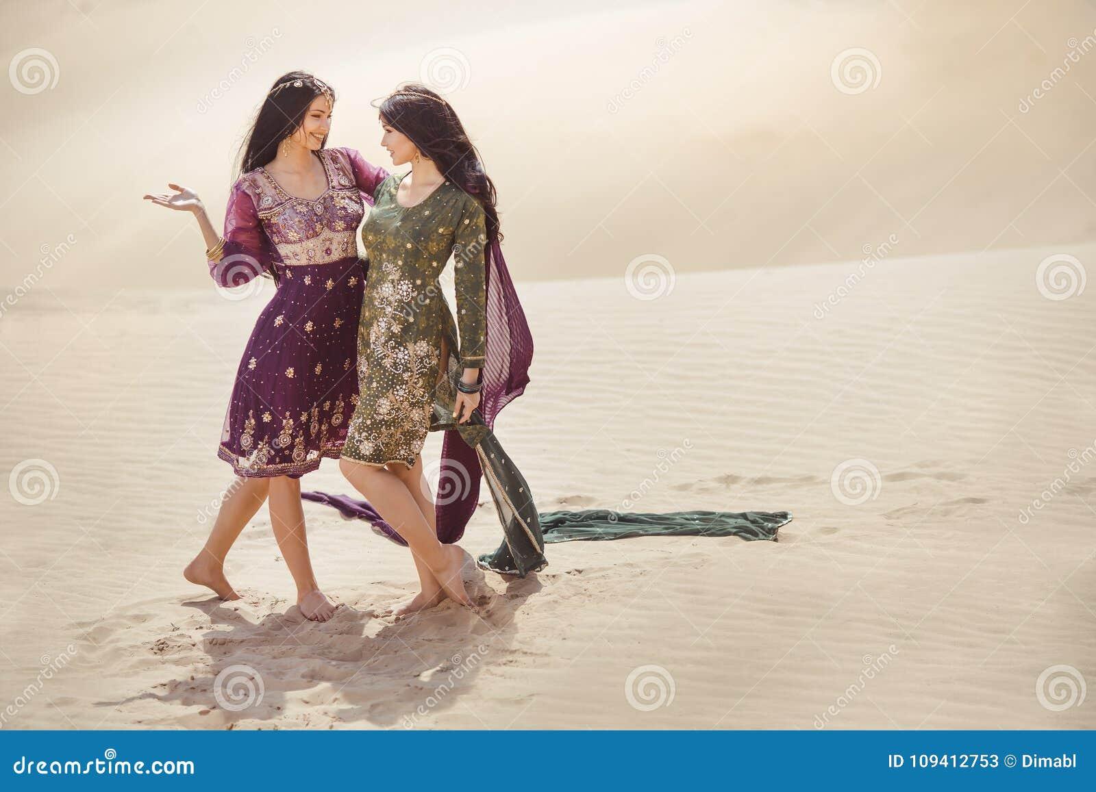 Women in desert landscape. Travel concept.