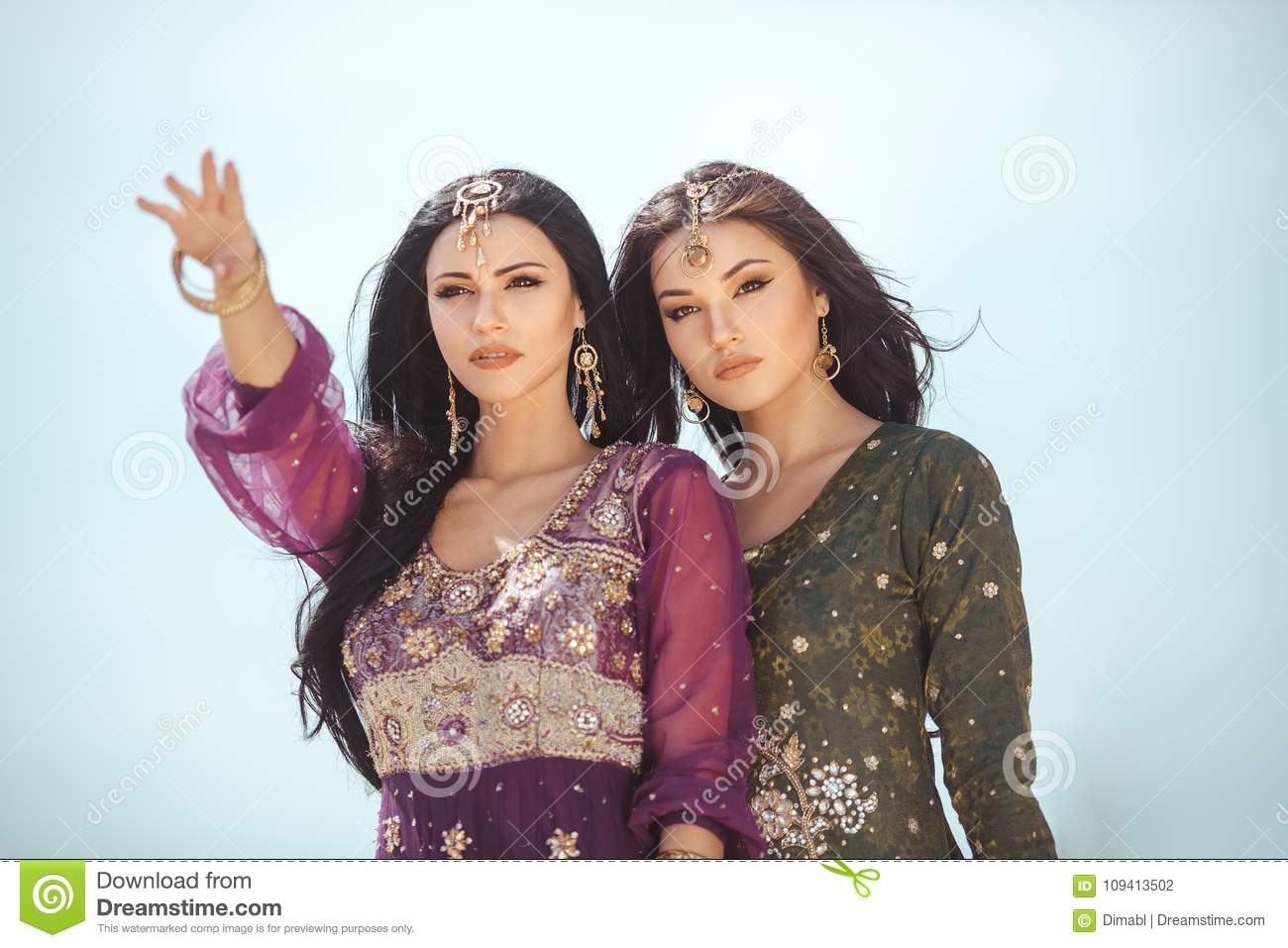 Travel concept. Two gordeous women sisters traveling in desert.