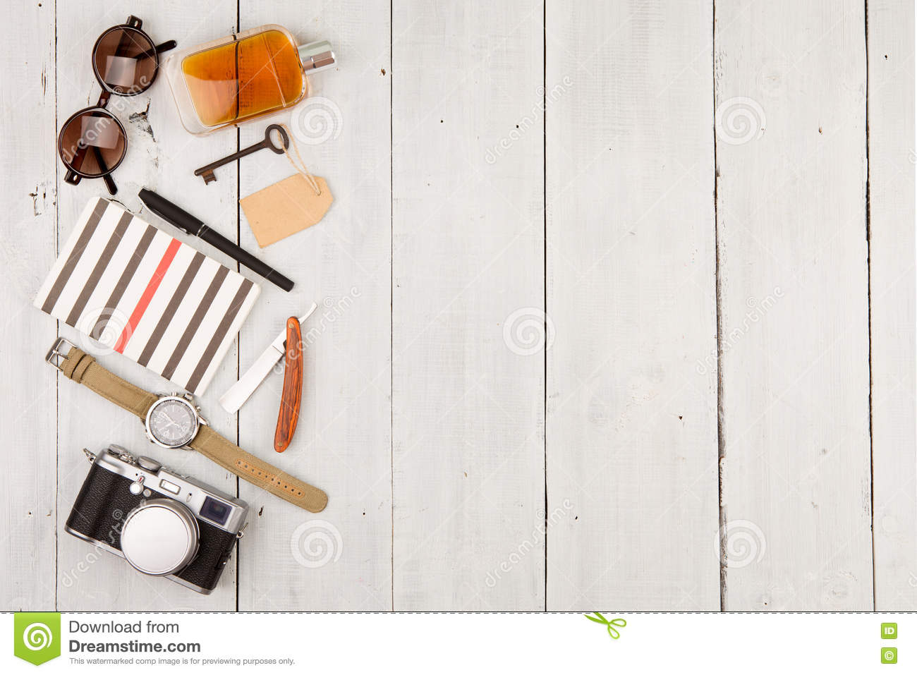 travel concept - set of cool stuff with camera and other things on wooden table