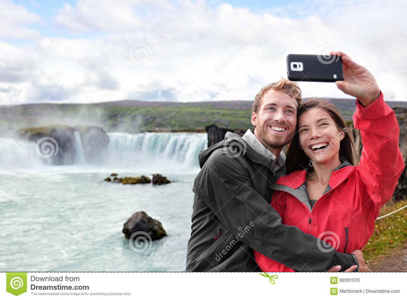 Travel couple taking phone selfie photo in Iceland