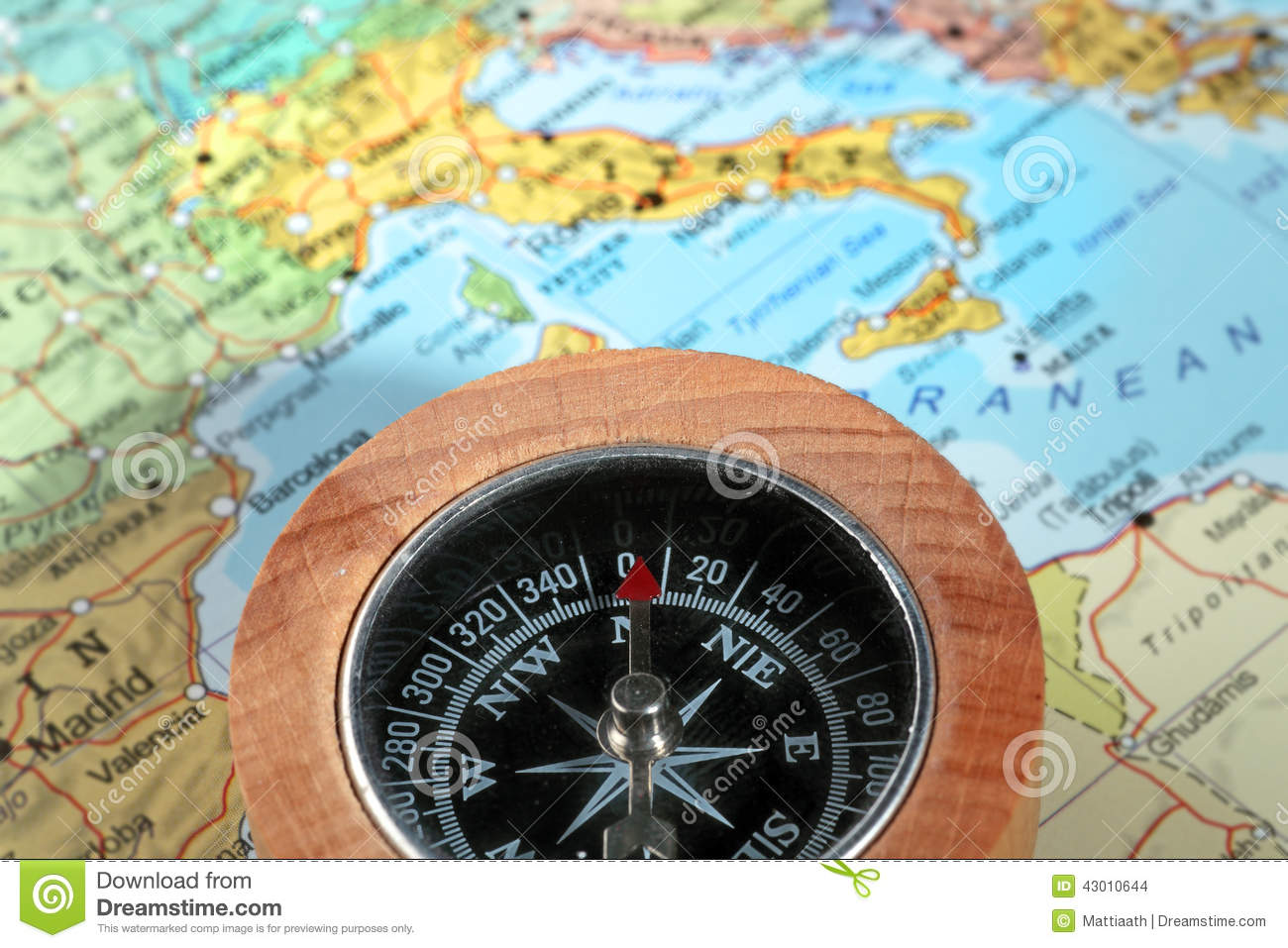 travel destination italy compass with a map on the background