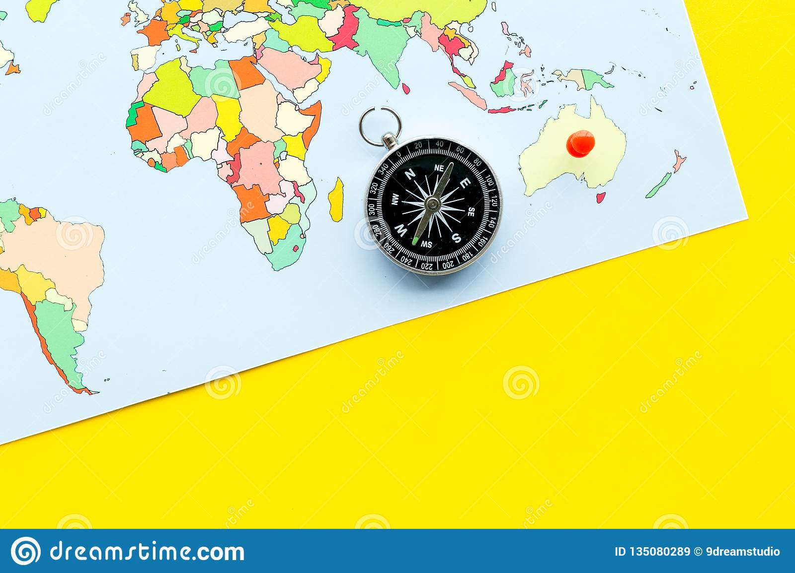Map Of The World With Compass.Travel Direction And Trip Planning Concept With Compass And Map Of