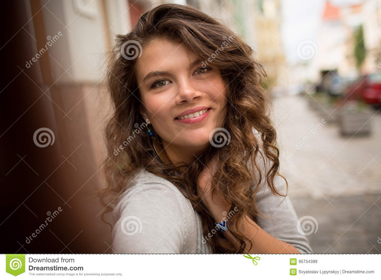Travel girl taking selfie shot, showing emotions of happiness.