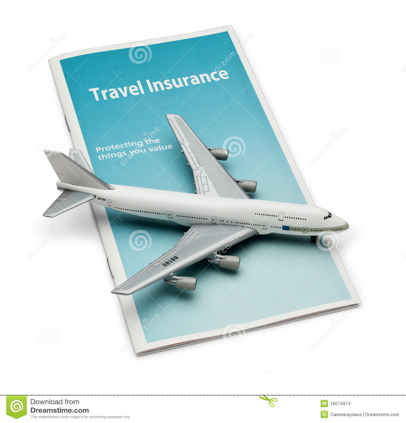 travel insurance brochure with a model airplane on top, isolated on ...